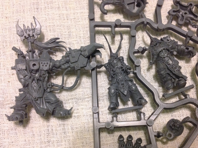 Ork Boss from ABR compared to the all new Chaos Lord in DV.  The Chaos Lord has finer detail.